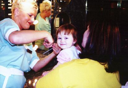 Rachel getting her first haircut